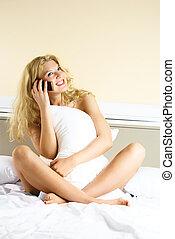 pretty girl talking on the cellphone - pretty blond girl...