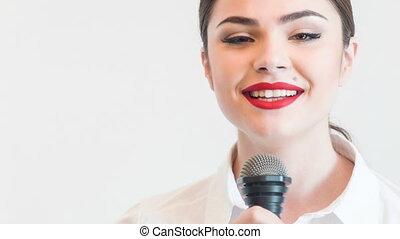 Pretty girl tv journalist is singing emotionally