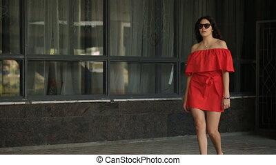Pretty girl walking on the street