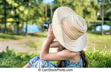 Pretty girl watching with the binoculars