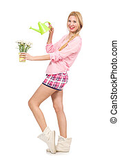 Pretty girl watering the flowers isolated on white