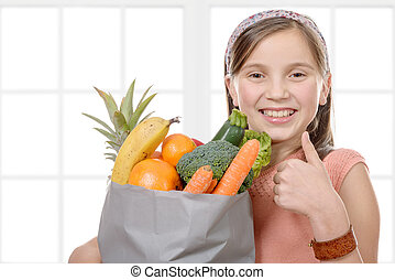 pretty girl with a bag full of fruits and vegetables