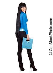 Pretty girl with a blue handbag. Isolated