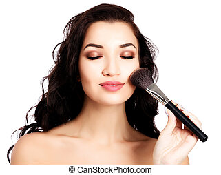 Pretty girl with a makeup brush
