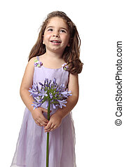 Pretty girl with beautiful flower smiling