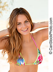 Pretty girl with beautiful hair and golden highlights in bikini