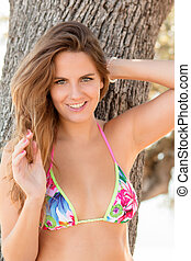 Pretty girl with beautiful hair and golden highlights in bikini