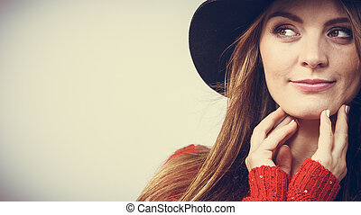 pretty girl with brown hair and black hat.