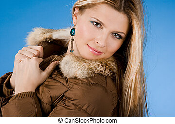 pretty girl with fur on coat