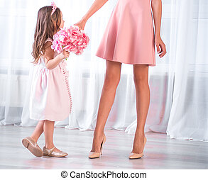 Pretty girl with mom in pink dress