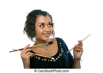 pretty girl with paint brushes