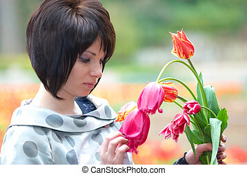 Pretty girl with tulips