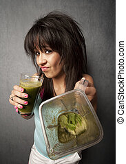 Pretty girl with unappetizing health shake - Pretty girl...