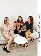 girls celebrating with glasses of wine