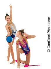 Pretty Girls Gymnasts Performing Rhythmic Gymnastics Exercise