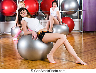 Pretty girls in fitness center