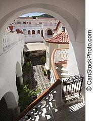 pretty greek courtyard with white house