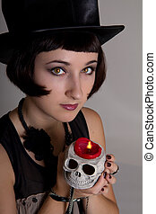 witch with a skull in a black cylinder hat