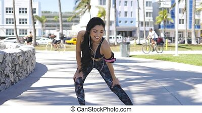 Pretty happy sportswoman training in park - Young ethnic...
