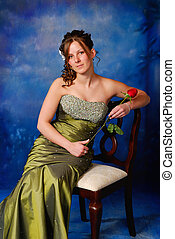 Portrait of a pretty high school graduate in prom dress.