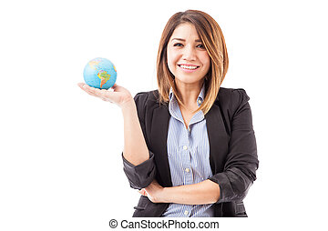 Pretty Hispanic businesswoman with a globe
