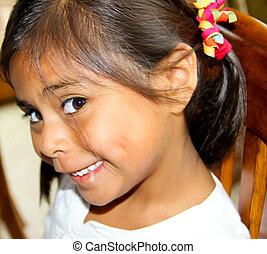 Pretty hispanic female child - coy looking hispanic female...