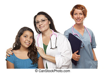 Hispanic Female Doctor with Child Patient and Colleague Behind