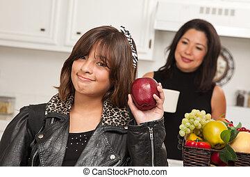 Pretty Hispanic Girl Ready for School with Mom