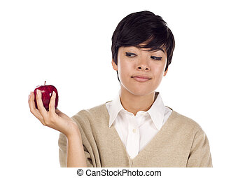 Pretty Hispanic Young Adult Female Looking at Apple in Hand Isolated on a White Background.