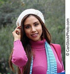 Pretty Hispanic Young Woman Wearing Sweater