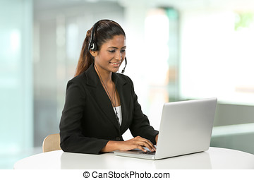 Pretty Indian call centre employee. - Portrait of a happy ...