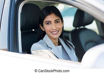 indian woman inside a car