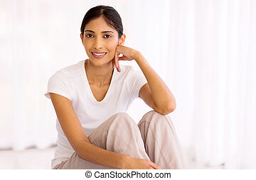 indian woman sitting in her new house