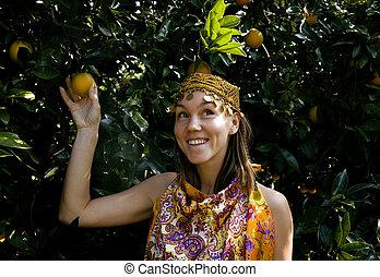 pretty islam woman in orange grove smiling close up