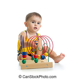pretty kid boy playing with color educational toy