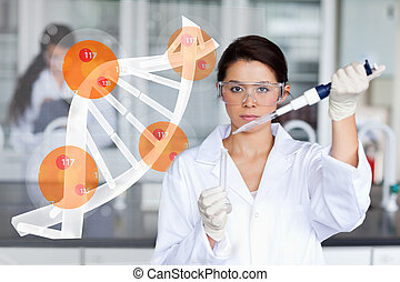 Pretty lab worker adding chemical to test tube with dna ...