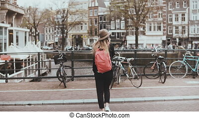 Pretty lady crosses street talking on the phone. 4K. Young...