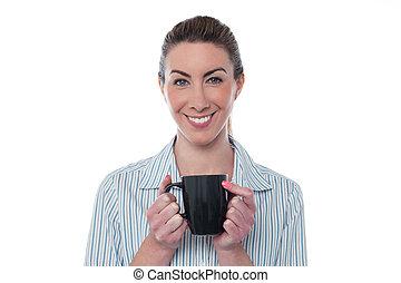 Pretty lady enjoying coffee