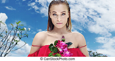 Pretty lady holding a bouquet of colorful flowers