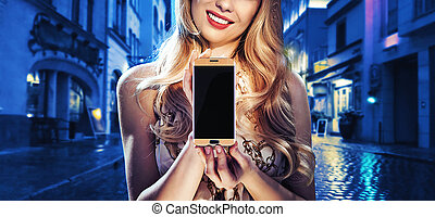 Pretty lady holding a mobile phone