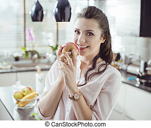 Pretty lady holding an apple