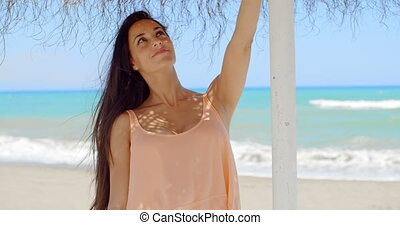 Pretty Lady Holding at the Beach Umbrella Stand