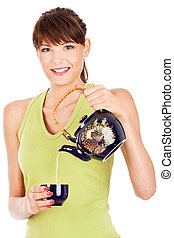Pretty lady smile and pouring tea from teapot