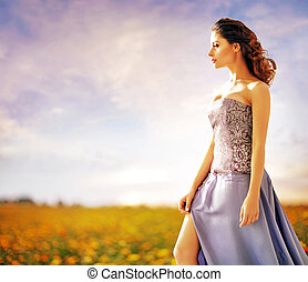 Pretty lady walking on the summer field