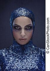 Pretty lady wearing a blue sequin uniform