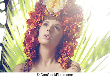 Pretty lady wearing hat made of flowers