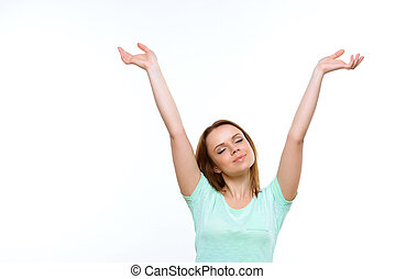 Pretty lady with closed eyes holding hands up - Feeling...
