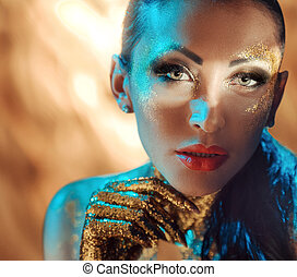 Pretty lady with glossy golden dust on the face