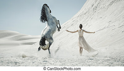 Pretty lady with huge horse on the desert - Pretty lady with...