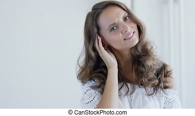Pretty lady with wavy hair - Beautiful young female with...